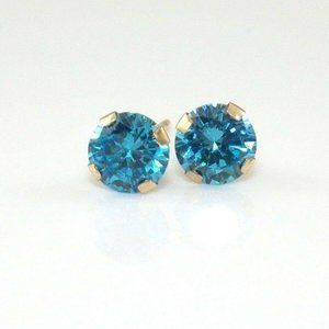 10K Gold Blue Topaz Stud Earrings